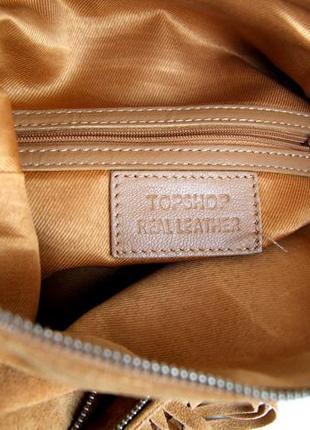 Стильная кожаная сумка через плечо  с бахромой9 фото