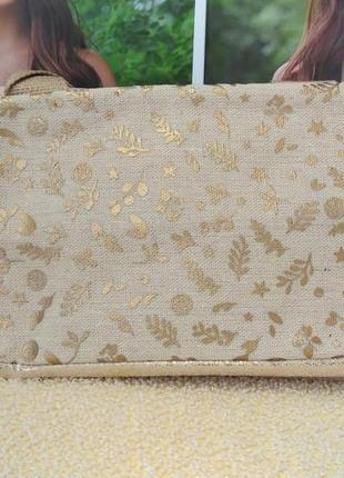 Золотистая сумочка-косметичка ив роше yves rocher