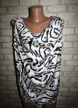 Красивая блуза р-р 14 сост новой