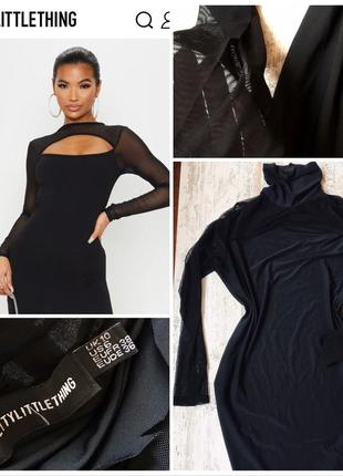 Чёрное платье с вырезом на груди