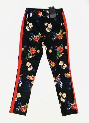 Цветочные брюки с лампасами