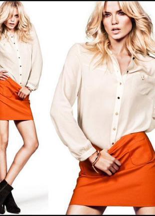 Оранжевая мини юбка трапеция с карманами