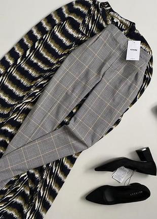 Новые трендовые брюки джоггеры в клетку sinsay