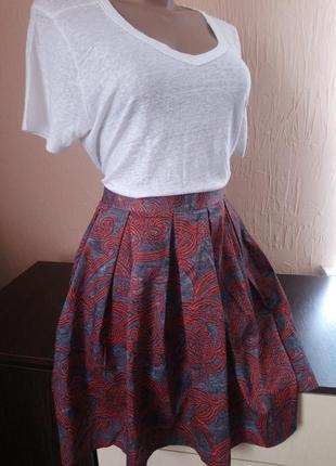 Трендова юбка міді із карманчиками .
