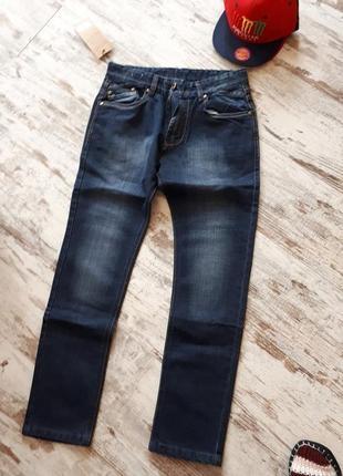 Фирменные синие джинсы. плотные мягкие. утяжка в талии