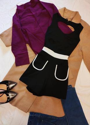Diva комбинезон трикотажный черный с белыми карманами и вырезом