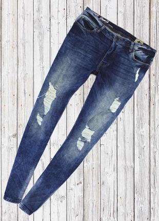 Стрейчевые джинсы с рваностями