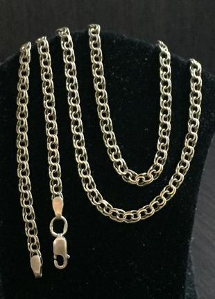 Серебряная цепочка. длинна :55 см.