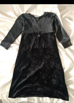 Шикарное платье длиной миди.