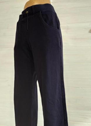 Теплые спортивные штаны с карманами l-xl4 фото