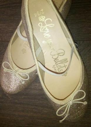 Балетки золотые туфли