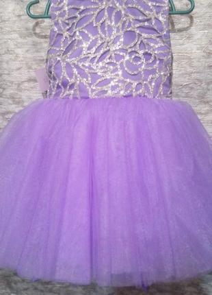 Красивое сиреневое пышное платье для маленькой леди.