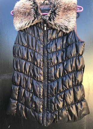 Женская жилетка
