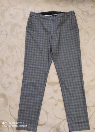 Стильныe брюки в клетку