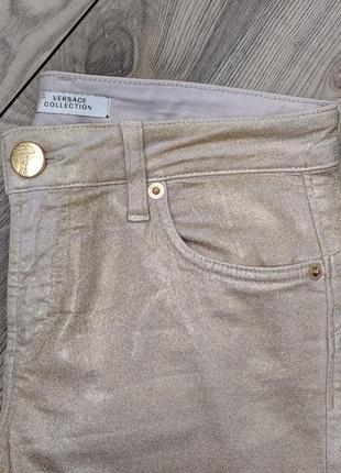 Фирменные брюки джинсы