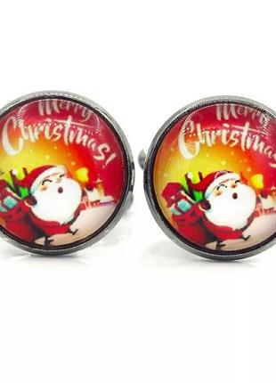 Запонки золотого цвета новогодней тематики с санта клаусом и надписью merry christmas