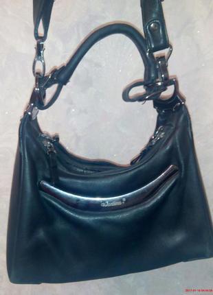 Фирменная кожаная сумка.
