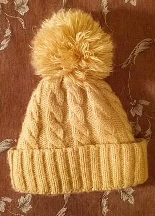 Утеплённая  зимняя вязаная шапка