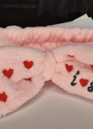Плюшевая розовая повязка бантик в сердечках