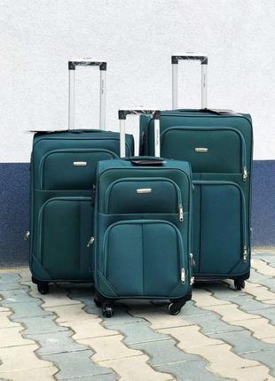 Комплект тканевых чемоданов на 4-х колесах