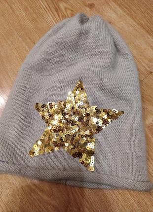 Стилтная шапка