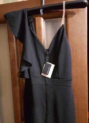 Нарядный черный комбинезон размер с3 фото