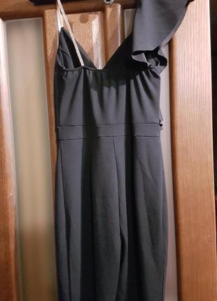 Нарядный черный комбинезон размер с4 фото