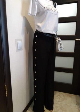 Спортшик длинные черные брюки штаны с кнопками