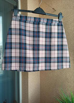 Красивая стильная юбка мини в клетку трапецией