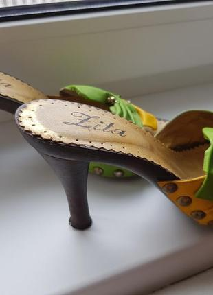 Кожаные шлепки на каблуке