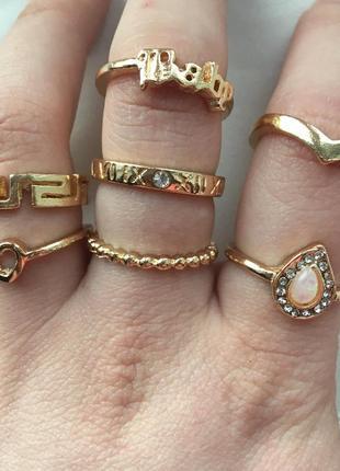 Кольца новые золотые