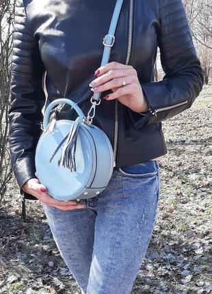 Кожаная круглая сумочка galanty с кисточкой