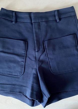 Брючные шорты синие