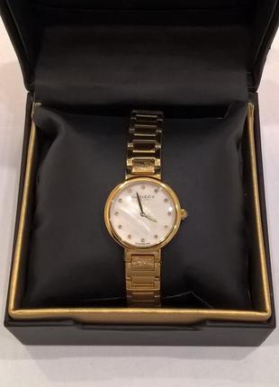 Часы с искуственными брильянтами akribos xxiv. оригинал. сша