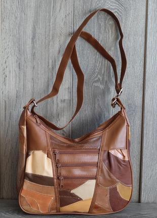 Стильная и легенькая кожаная сумка