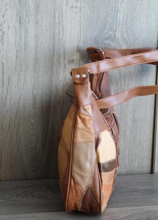 Стильная и легенькая кожаная сумка2 фото
