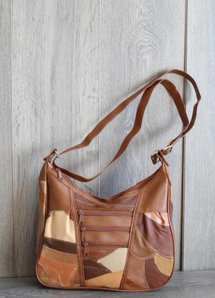 Стильная и легенькая кожаная сумка7 фото