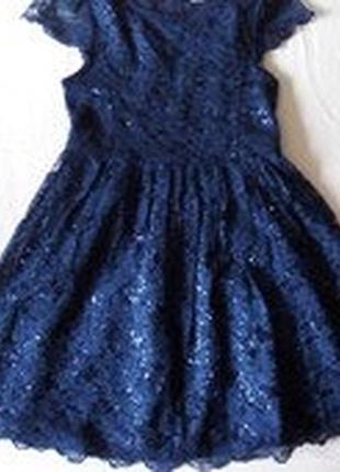 Шикарное кружевное платье с паетками.tu.7-8 л.