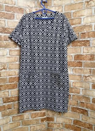 Платье из плотного трикотажа с карманами