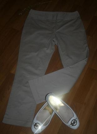 Дизайнерские бежевые котоновые брюки