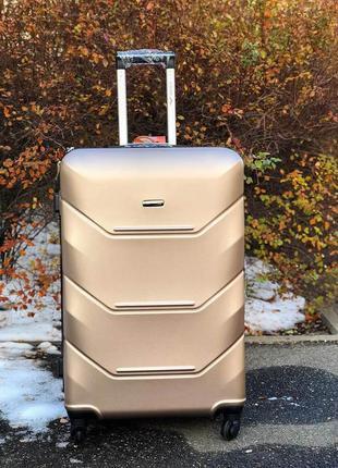 Оригинал польша! средний чемодан пластиковый 4-х колесный / валіза велика пластикова