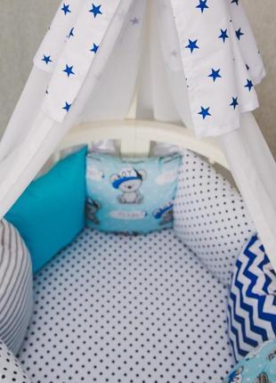 Простынь на резинке в круглую кроватку