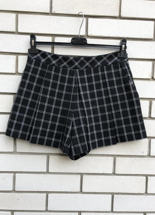 Шорты-юбка в клетку с карманами бо бокам new look