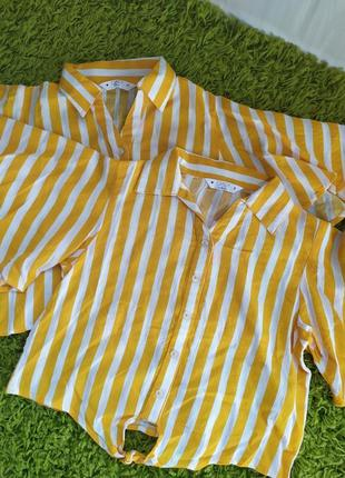 Жовта блузка в полоску