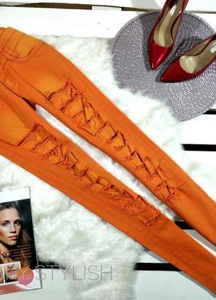 Оранжевые джинсы с ажурной сеточкой в середине