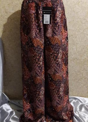 Шикарные очень расклешенные штаны на высокий рост или высокий каблук