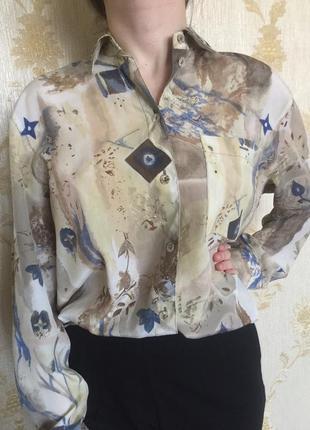 Стильная рубашка с длинным рукавом.