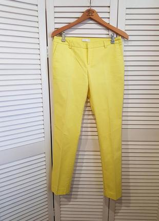 Стильные желтые брюки promod