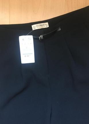 Стильные высокие брюки момы с защипами