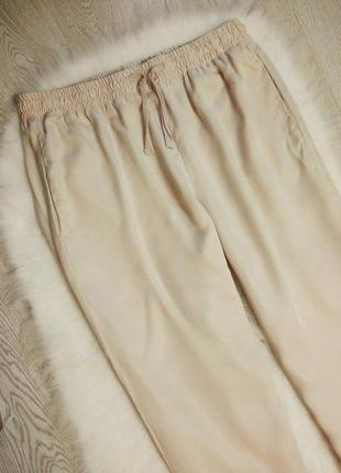 Бежевые нюд брюки штаны джоггеры на резинке с карманами офисные свободные батал3 фото